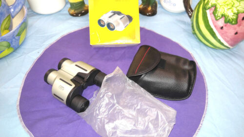 Binoculars by UCF zoom 7- 15x25 with case and strap