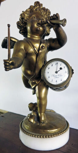 Early 19th Century  Antique Bronze Clock with Cherub playing a drum and trumpet