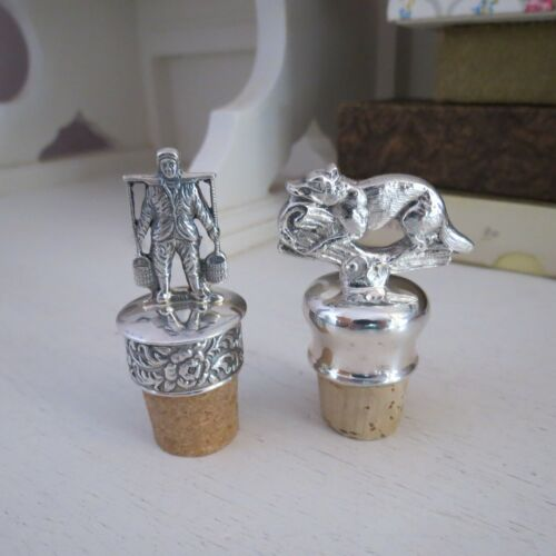Two vintage silver plated wine bottle stoppers Dutch boy & fox