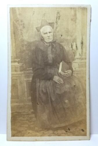Catholic priest or bishop holding a bible, CDV photo c. 1870