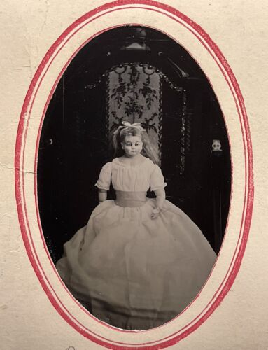 VERY RARE 1/6 PLATE TINTYPE OF A BEAUTIFUL BISQUE DOLL WITH ARTICULATED JOINTS