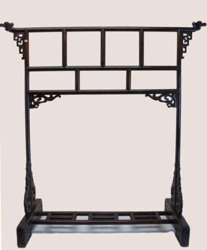 A Chinese Qing Dynasty Dark Wood Clothing Hanger w/ intricate pattern design