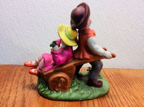 Boy with a Wheel Barrow and Girl inside ~ Made of Porcelain ~ Figurine Statue