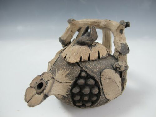 A Chinese Clay Carved Leaf and Pine Cone Teapot With Cicada