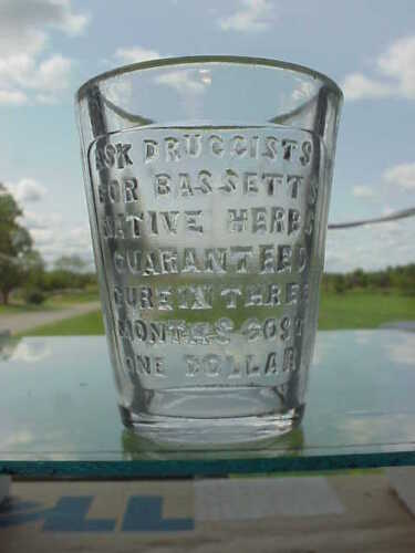 Embossed Bassett's Native Herbs With Embossed CURE Medical Shot Glass