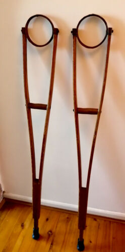 Rare early Antique Wooden crutches with leather-bound metal arm rings