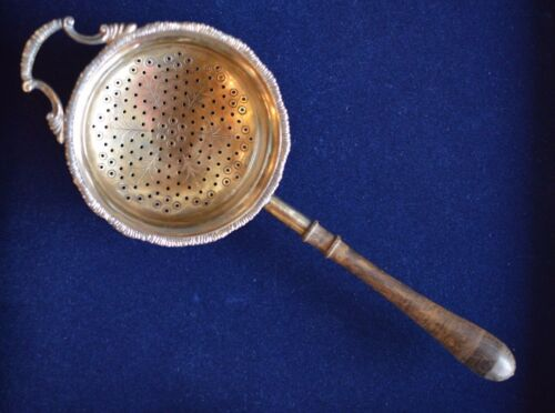English Sterling Silver and Berlwood Tea Strainer