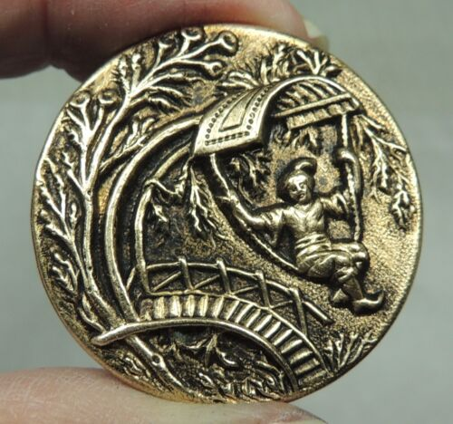 ANTIQUE BRASS PICTURE BUTTON ~ BOY IN EARLY HANG GLIDER