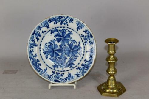 "A RARE 17TH C DUTCH DELFT TIN GLAZE 9"" DEEP PLATE WITH A BLUE FLORAL DECORATION"