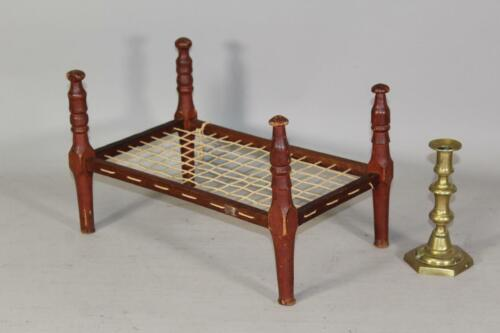 AN EXTREMELY RARE EARLY 18TH C PERIOD CHILD'S DOLL BED IN ORIGINAL RED PAINT
