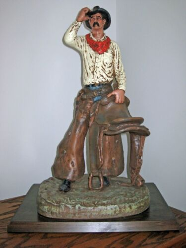 SADDLE TRAMP SCULPTURE by MICHAEL GARMAN and WOOD BASE