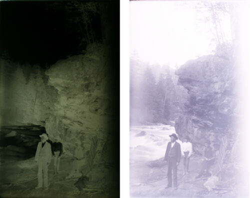 1920S 5X8 GLASS NEGATIVE OF THREE MEN POSING NEAR LARGE CLIFF - IN ENVELOPE