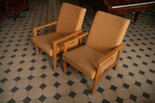 pair of beige lounge chairs