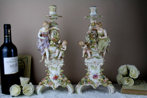 PAIR german porcelain majolica encrusted floral decor putti candle holders