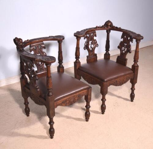 *Pair of Antique Walnut Gothic Revival Highly Carved Gossip Chairs with Griffins