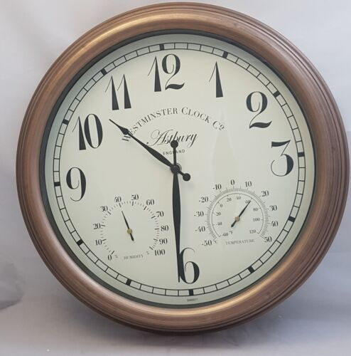Copper Coloured Clock With Thermometer and Hygrometer.