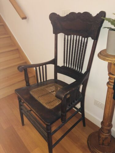 Antique oak press back chair with arms cane seat 1900's Victorian