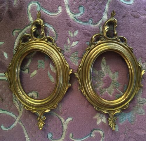 A pair of gold leaf Italian picture frames