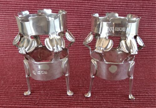 A pair of crown shaped silver vase stands. London 1906.