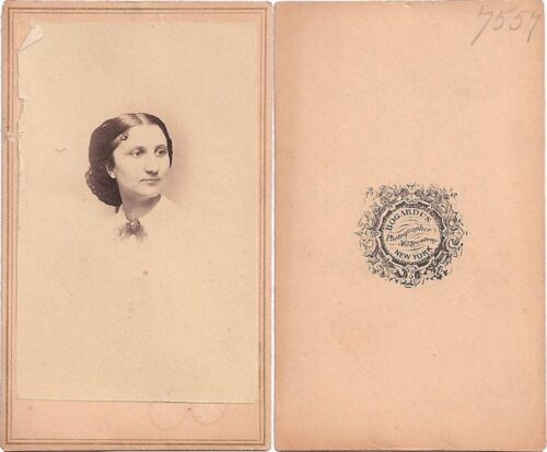 YOUNG LADY WITH STYLIZED HAIR, WHITE BLOUSE + BROACH, BY BOGARDUS, NY, CDV
