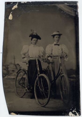 EARLY BICYCLES   TWO LADIES W/ LONG SKIRTS   HATS TINTYPE