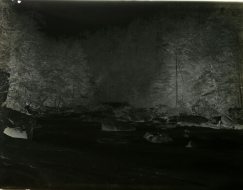 1920S 6X8 GLASS NEGATIVE OF RIVER WITH MANY LARGE BOULDERS SURROUNDED BY TREES