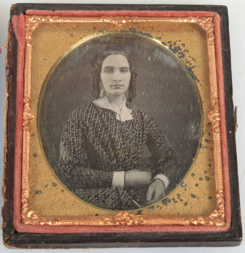DAGUERREOTYPE WOMAN WITH RINGLET CURLS, THICK BROWS, PRINTED DRESS.