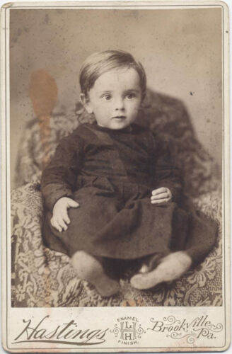 CABINET CARD FROM BROOKVILLE PA, LARGE EYED BABY IN DARK COLORED DRESS.
