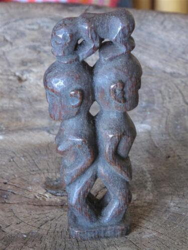 Old Sumatran Back to Back Men Wood Carving… with a monkey or dog on there heads