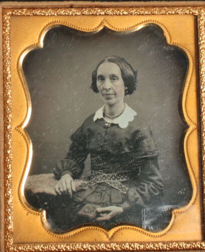 DAGUERREOTYPE WOMAN HOLDING UNION CASE, TINTED 1/6TH PLATE, CALAMITY FULL CASE.