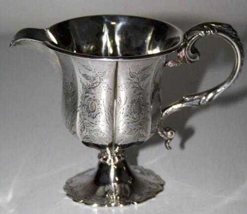 PITCHER ENGLISH. STERLING SILVER. EMBOSSED HAND. ENGLAND. CENTURY XVIII-XIX.