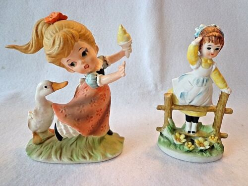 VINTAGE SET OF GIRL FIGURINES-ONE LOOKING YONDER & OTHER BEING CHASED BY DUCK