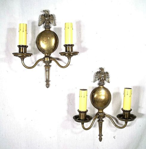 LARGE PAIR OF MID CENTURY DOUBLE ARM EAGLE PERCHED ON GLOBE BRASS SCONCES