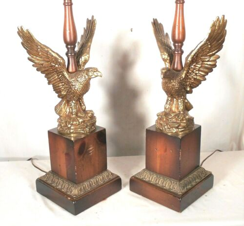 PAIR OF MID CENTURY CLASSICAL OUTSTRETCHED EAGLE LAMPS ON A WOOD PLINTH BASE