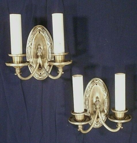 ANTIQUE PAIR OF EARLY 20th CENTURY CLASSICAL OVAL BACK SILVER PLATE SCONCES
