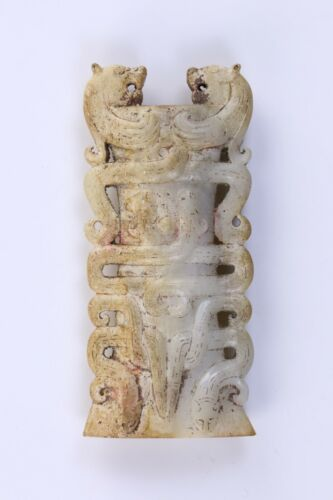 A CHINESE ARCHAIC JADE STONE CARVING