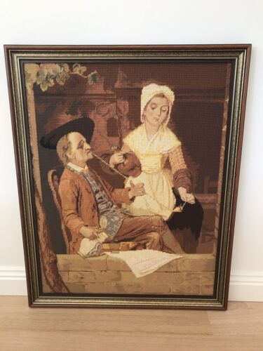 Antique dutch ? scene large framed tapestry petit point woman lighting mans pipe