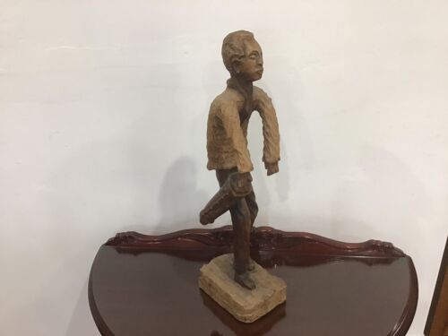 Timber statue of a man