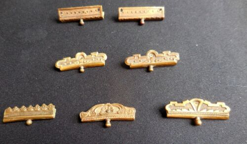 """7 antique decorated Brass Clasps, approximately 1 1/4"""" long by  3/8"""" wide, +/-"""