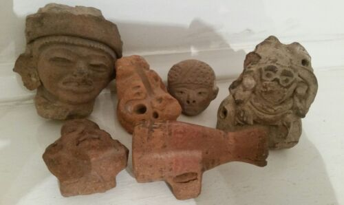 Pre-columbian pottery, six pieces including heads and an ocarina