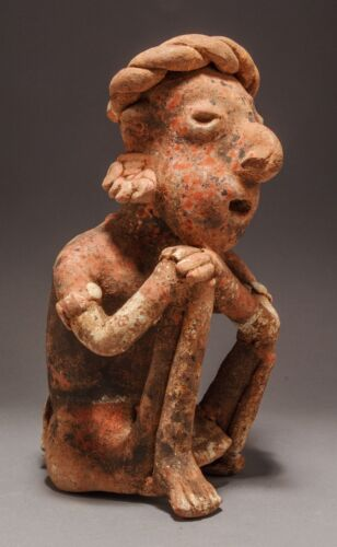 A Pre-Columbian Nayarit Polychrome Seated Female Figure, Ixtlan del Rio Style