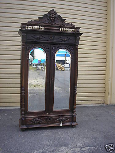 00001 Antique French Wardrobe w/Carved Figural Top & Beveled Mirror Doors