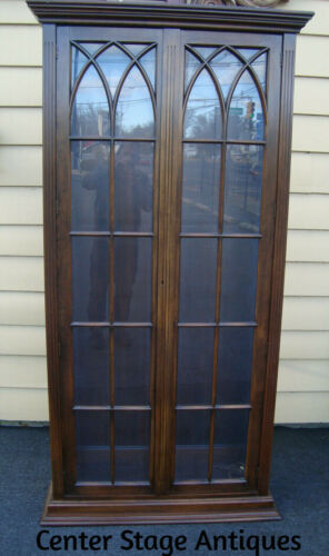 61589   Mahogany 2 door Curio Cabinet with lattice work in the doors