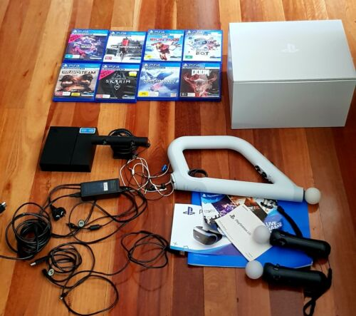 Full PS4 VR headset, controllers, gun and 8 games.