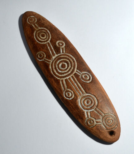 Great Aboriginal bullroarer with incised decoration and white and ochre pigment
