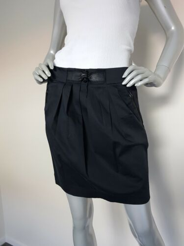 MAX&Co. women's black stretch straight pleat Skirt with leather detail. Size 10