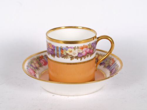 A SEVRES CUP AND SAUCER WITH GARLANDS CIRCA 1800