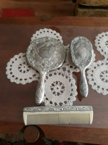 Vintage three peice silver plated mirror,brush and comb.