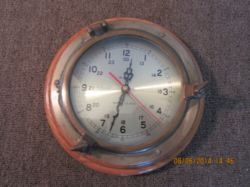 "NAUTICAL, 9 1/2"" WOOD & BRASS, PORTHOLE CLOCK"
