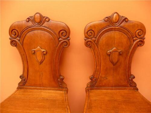 OAK honey coloured shield back HALL CHAIRS 'coffin chairs'.nicely carved antique